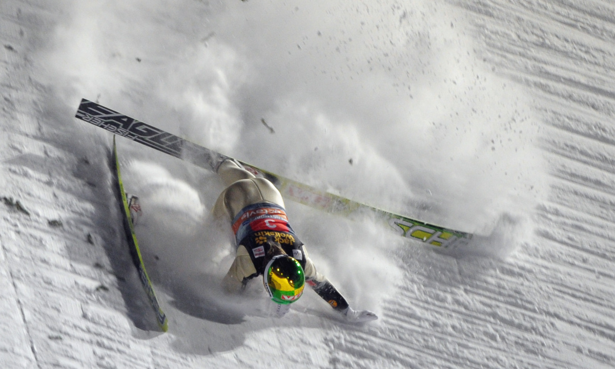 Norway's Tom Hilde falls during the first jumping event of the 60th edition of the Four-Hills-Tournament on Dec. 30, 2011 in