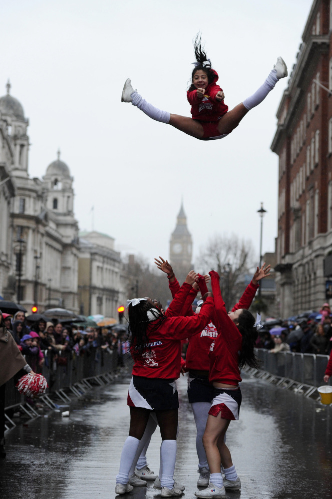 Cheerleaders take part in the New Year's Day Parade in central London on January 1, 2012. AFP PHOTO/CARL COURT