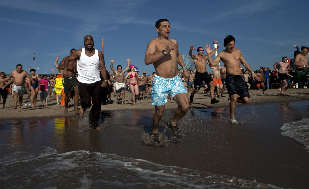 NEW YORK, NY - JANUARY 01: People take part in the annual Coney Island Polar Bear Club New Year's Day swim at Coney Island on