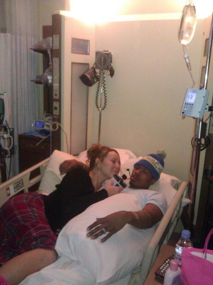 Along with her well wishes, Mariah tweeted this photo of a bedridden Nick.