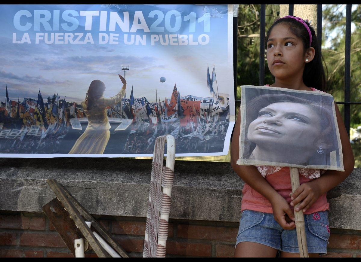 A girl holds a portrait of Argentine President Cristina Fernandez de Kirchner outside the Austral Hospital in Pilar, Buenos A