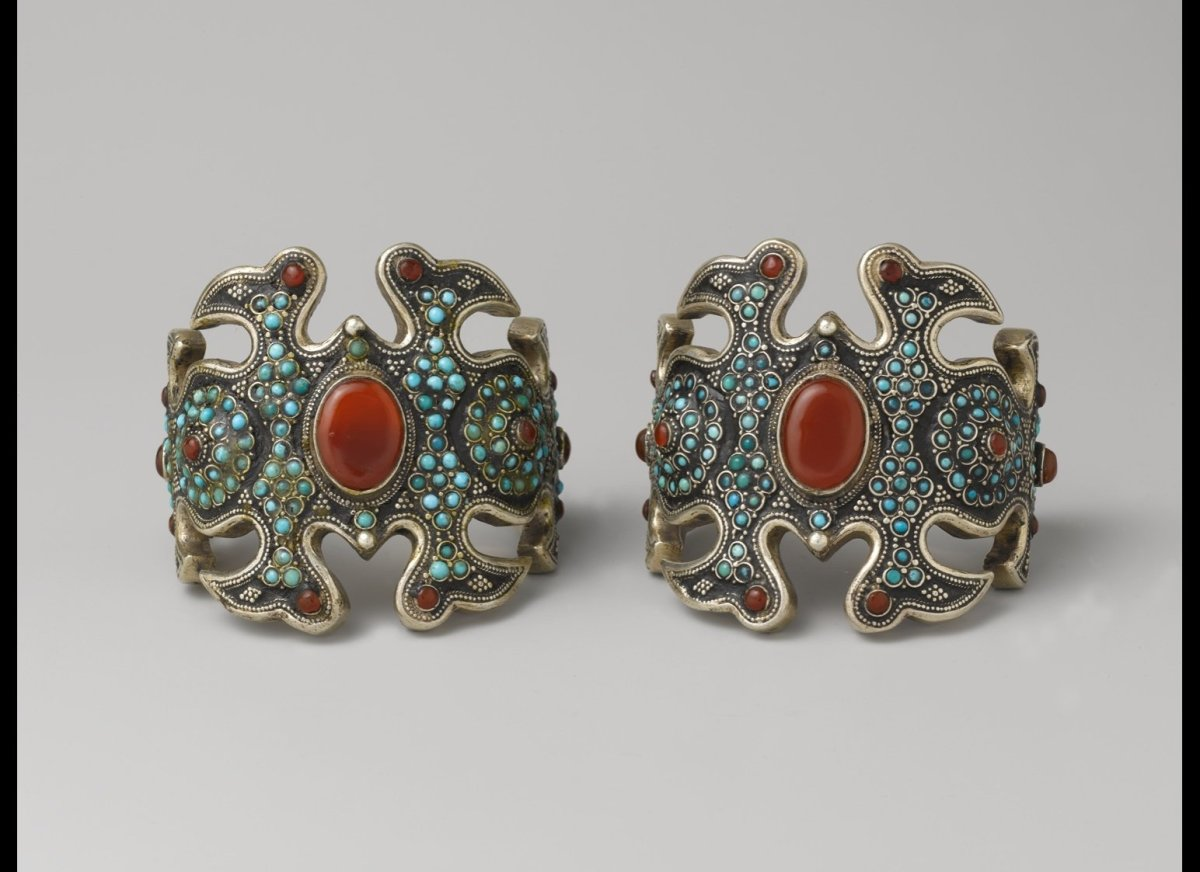<b>Pair of armbands</b><br>20th century; Central Asia; Kazakh; Silver, with silver shot, unidentified black material, slightl