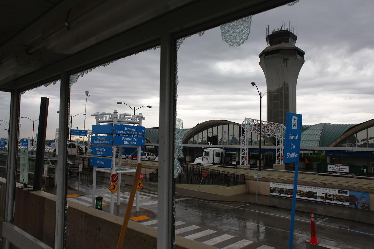 The control tower is seen through broken glass at Lambert-St. Louis International Airport April 23, 2011 in St. Louis, Missou