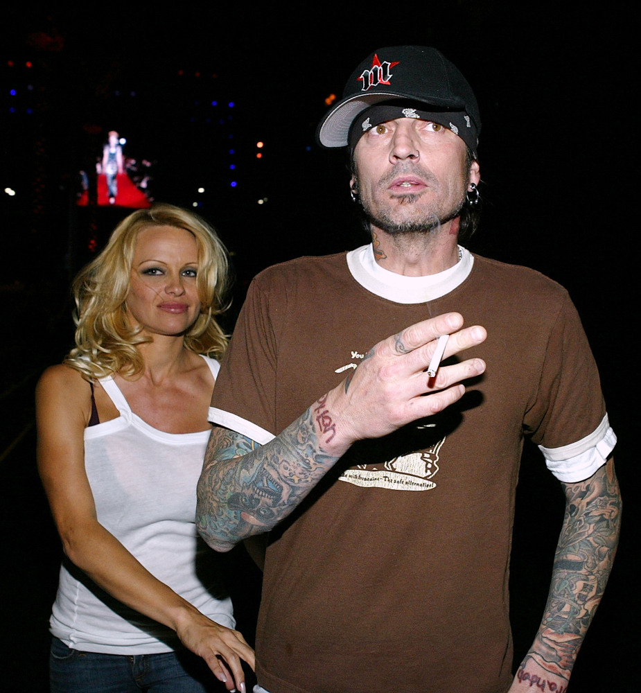 "Pamela Anderson and Mötley Crüe's Tommy Lee <a href=""http://www.people.com/people/pamela_anderson/biography/0,,20006212_10,00"