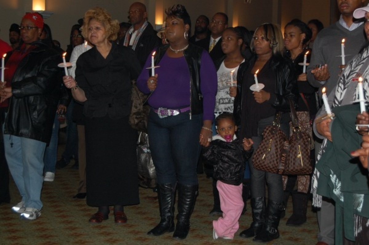 Family, friends and supporters gathered Jan. 12 for a candlelight vigil at the Park Tavern in Atlanta. Frank Ski from <u><a h