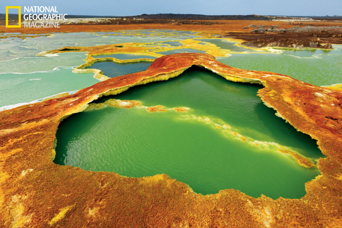 Sulfur and algae turn hot springs into pools of living color. The water is condensation from hot gases rising from magma cham