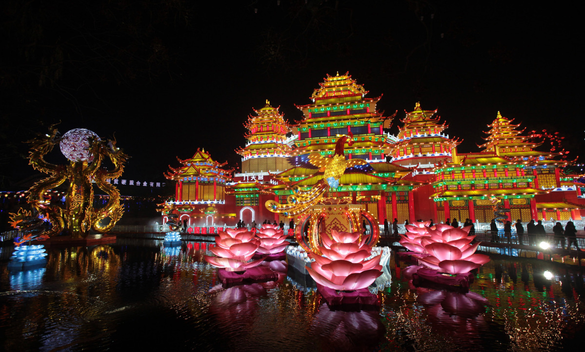 Visitors view lanterns and lights at the 18th Zigong International Lantern Festival on Jan. 5, 2012 in Zigong of Sichuani Pro
