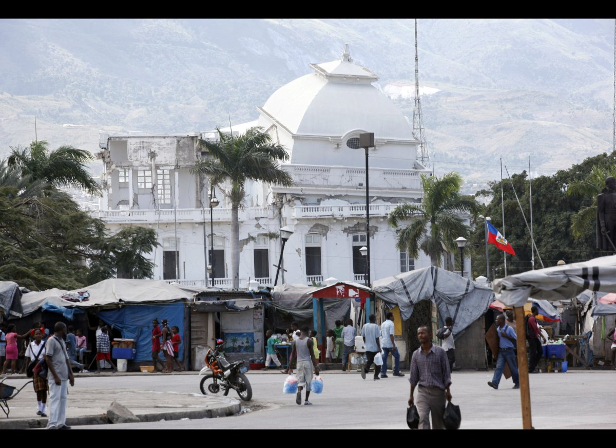 The ruined Presidential Palace overlooks the displaced persons camp at Champ de Mar, in Port-au-Prince, Haiti, Wednesday, Jan