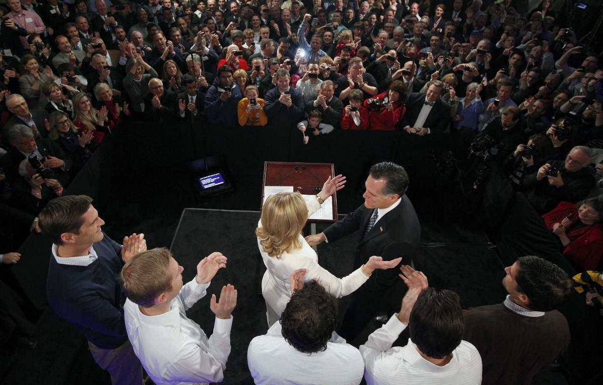Former Massachusetts Gov. Mitt Romney reaches for his wife Ann as his sons, Josh, Ben, Craig, Tagg and Matt (L-R) look on dur