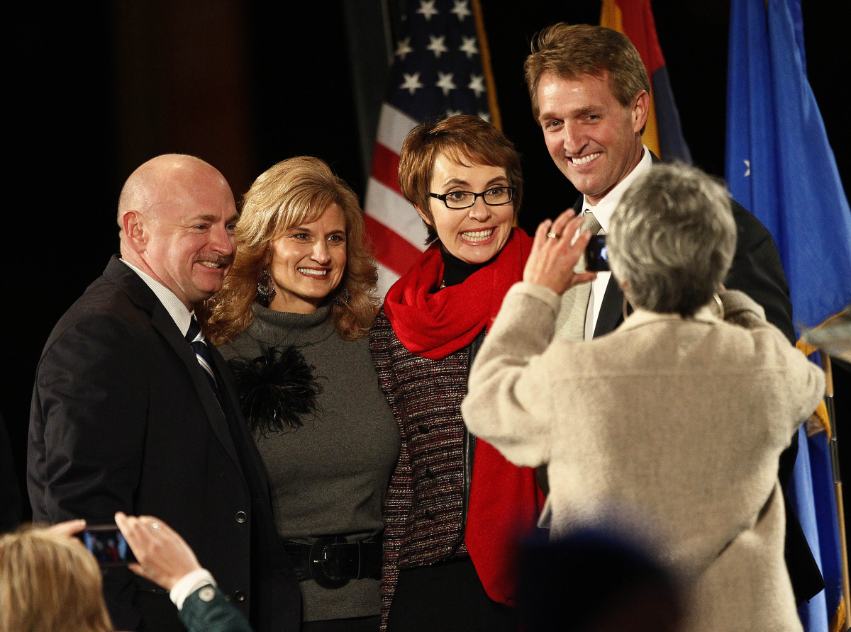 U.S. Rep. Jeff Flake, R-Ariz., right, and wife Cheryl, second from left, pose for a photograph with Rep. Gabrielle Giffords,