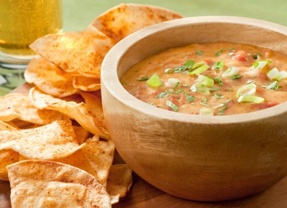 This version of chile con queso includes beer for a flavor boost. The recipe is made with a white sauce base to ensure the di