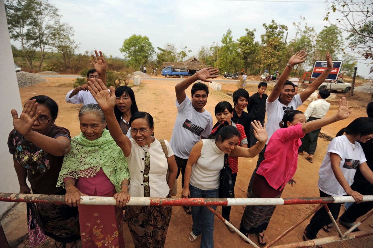 Relatives of Myanmar blogger and prominent political activist Nay Phone Latt wave upon his release from detention in Hpa-an,
