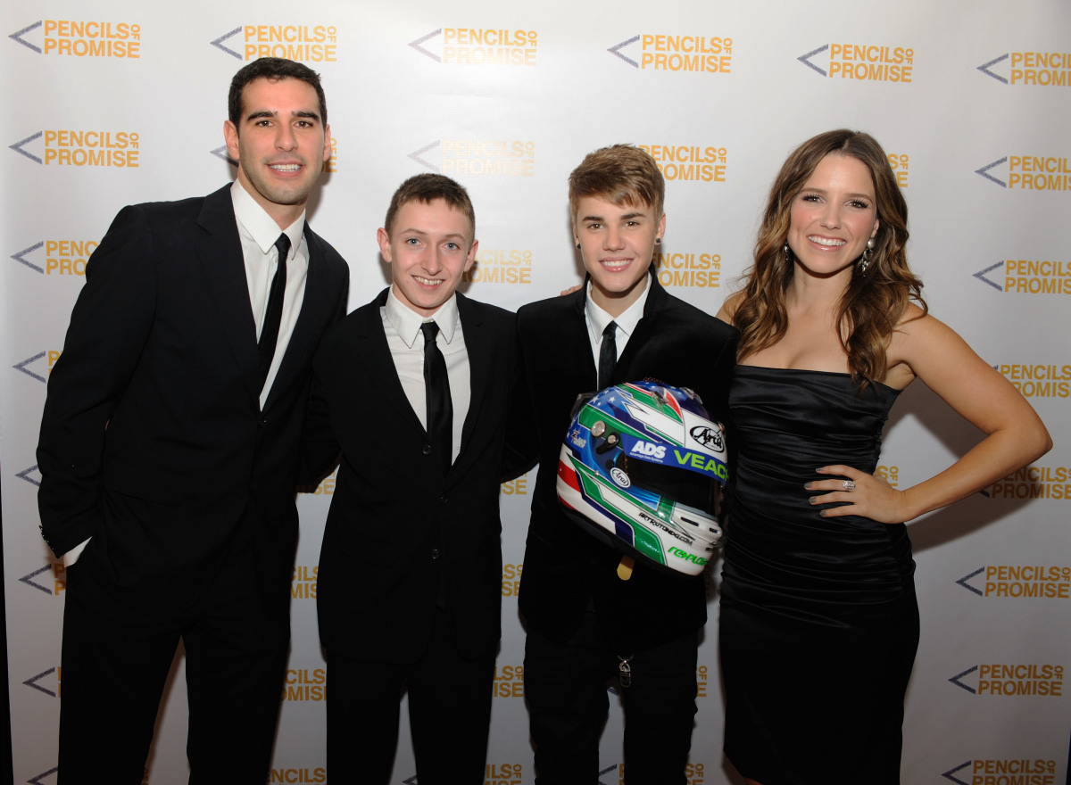 Adam Braun, founder of Pencils of Promise, Zach Veach, musician Justin Beiber and One Tree Hill's Sophia Bush on the red carp