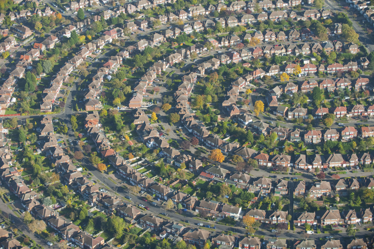An aerial view of houses in the suburb of north east London, England.  AT 2,400 feet up these homes from across the world are