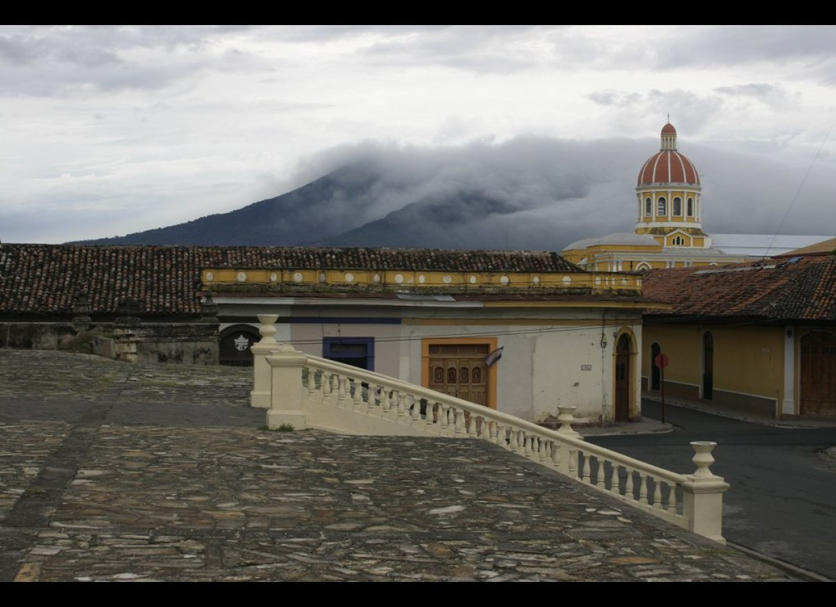 Founded in 1524, Granada is the oldest colonial city in Nicaragua. The Cathedral of Granada, seen in the background, stands a