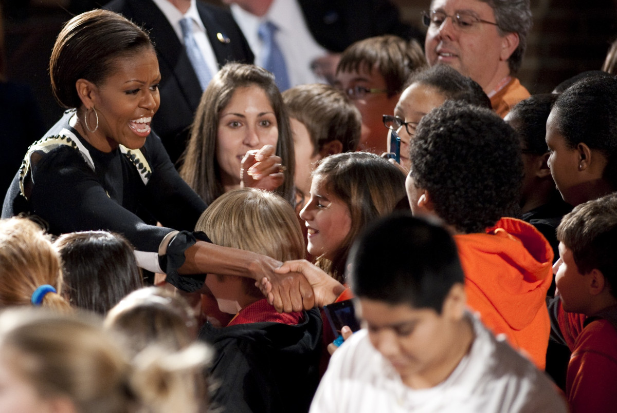 US First Lady Michelle Obama greets students during a screening of the Nickelodeon television show iCarly featuring Obama at