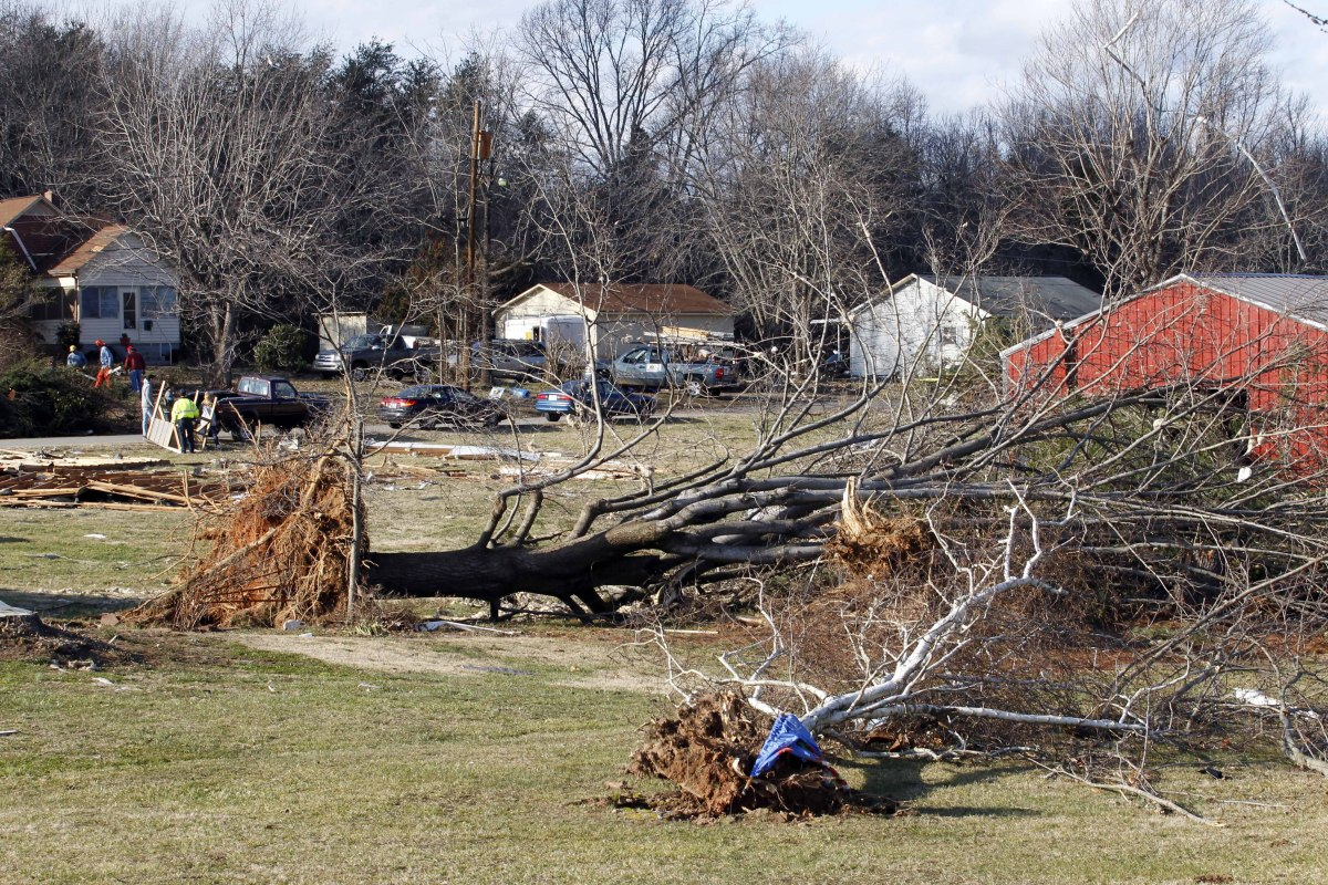 <em>From AP:</em> Fallen trees litter the yards of residents on Yoder St. near Hildebran, N.C. as they clean-up storm damage