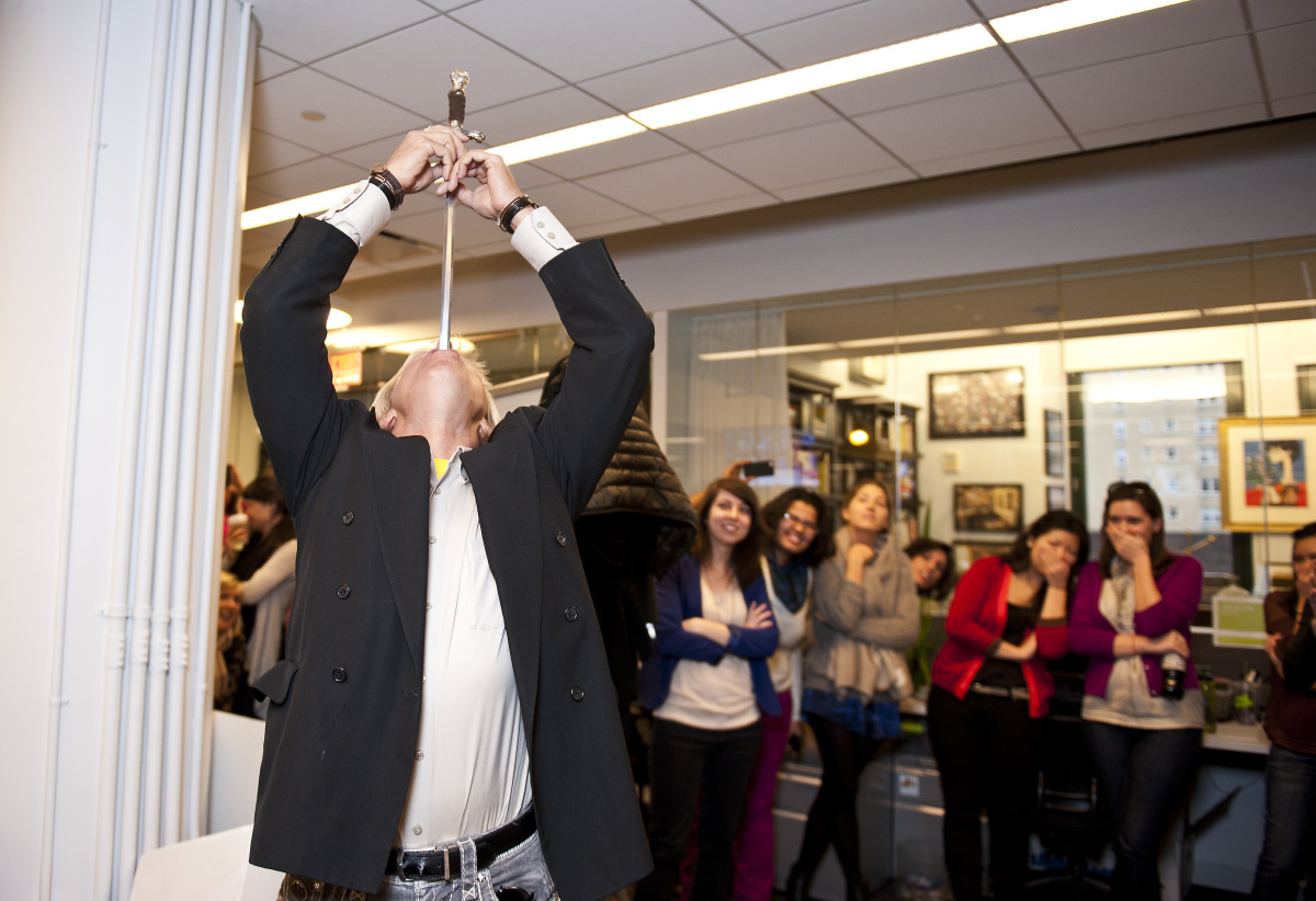 Dan Meyer, a professional sword swallower visits The Huffington Post and shows off his talent in the Huffington Post newsroom