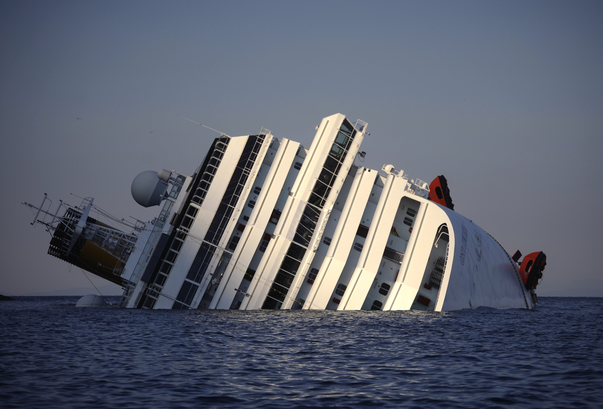 View of the Costa Concordia taken on January 14, 2012, after the cruise ship ran aground and keeled over off the Isola del Gi