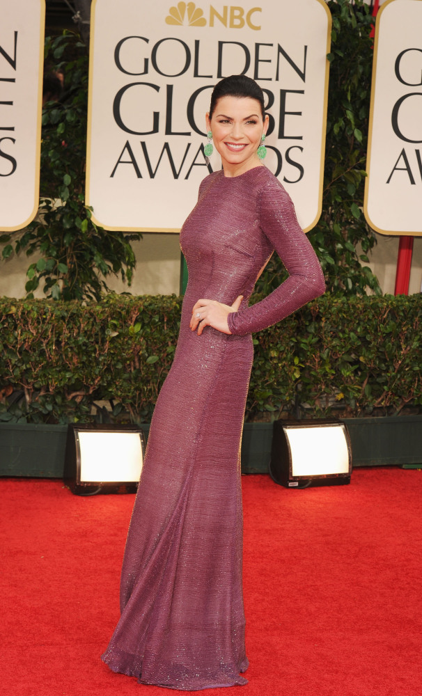 """The Good Wife"" actress got it right--the plum hue of the dress and jade earrings are stunning with her coloring.