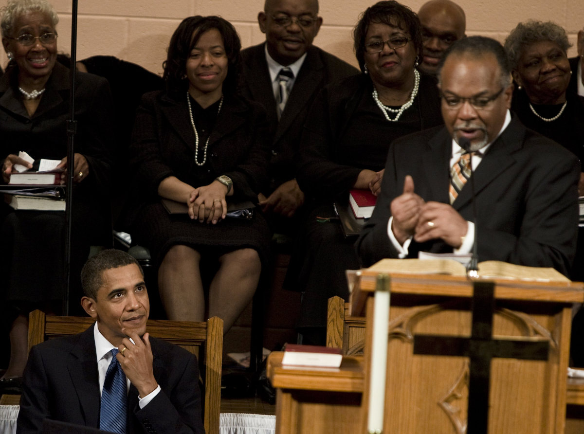 President Barack Obama listens to an introduction by Pastor Cornelius Wheeler at Vermont Avenue Baptist Church in the Distric