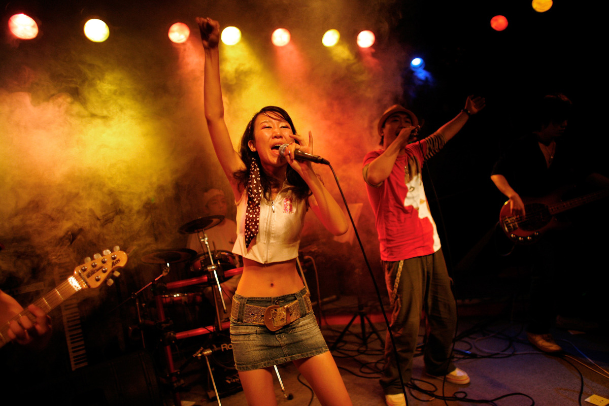 A band performs inside one of the clubs in Beijing's Sanlitun night club district. (Photo Paula Bronstein/Getty Images)