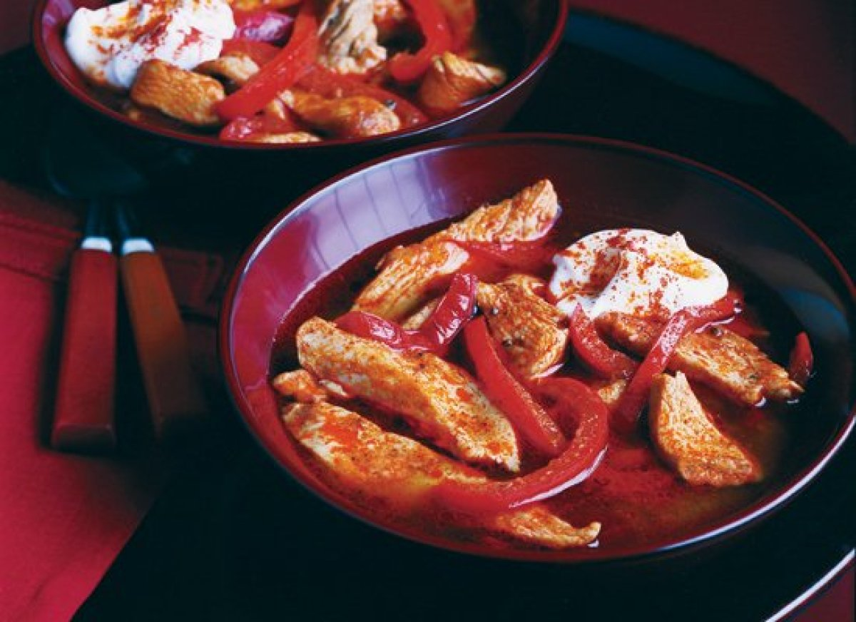 This classic Hungarian dish features chicken braised with onions and red bell peppers in a rich, red broth. Paprika, the spic