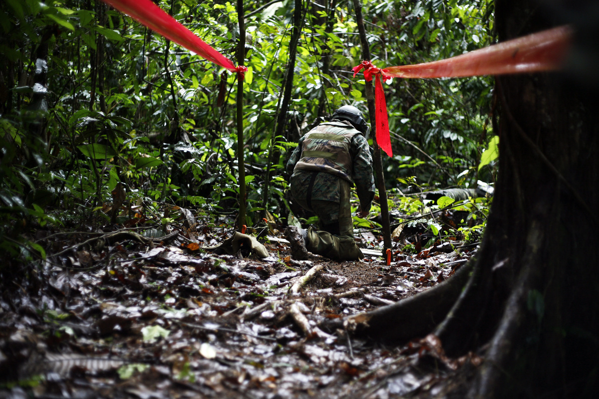 Soldiers look for mines in Morona Santiago, Ecuador Nov. 17, 2011. Even though the safety protocol is meticulous, most of the