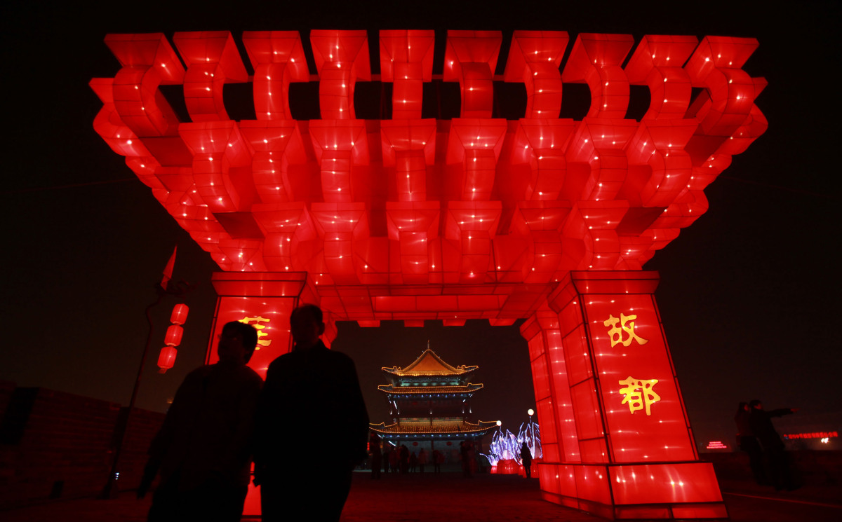 Tourists view lighting decorations at the City Wall New Year Lantern Festival on Jan. 16, 2012 in Xian of Shaanxi Province, C