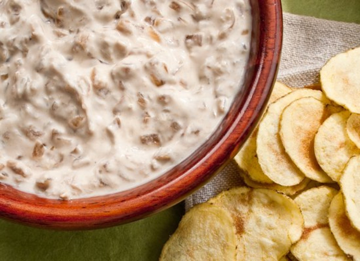 This homemade version of French onion dip starts with sauteing the onions until very brown. Then they're simmered in broth un