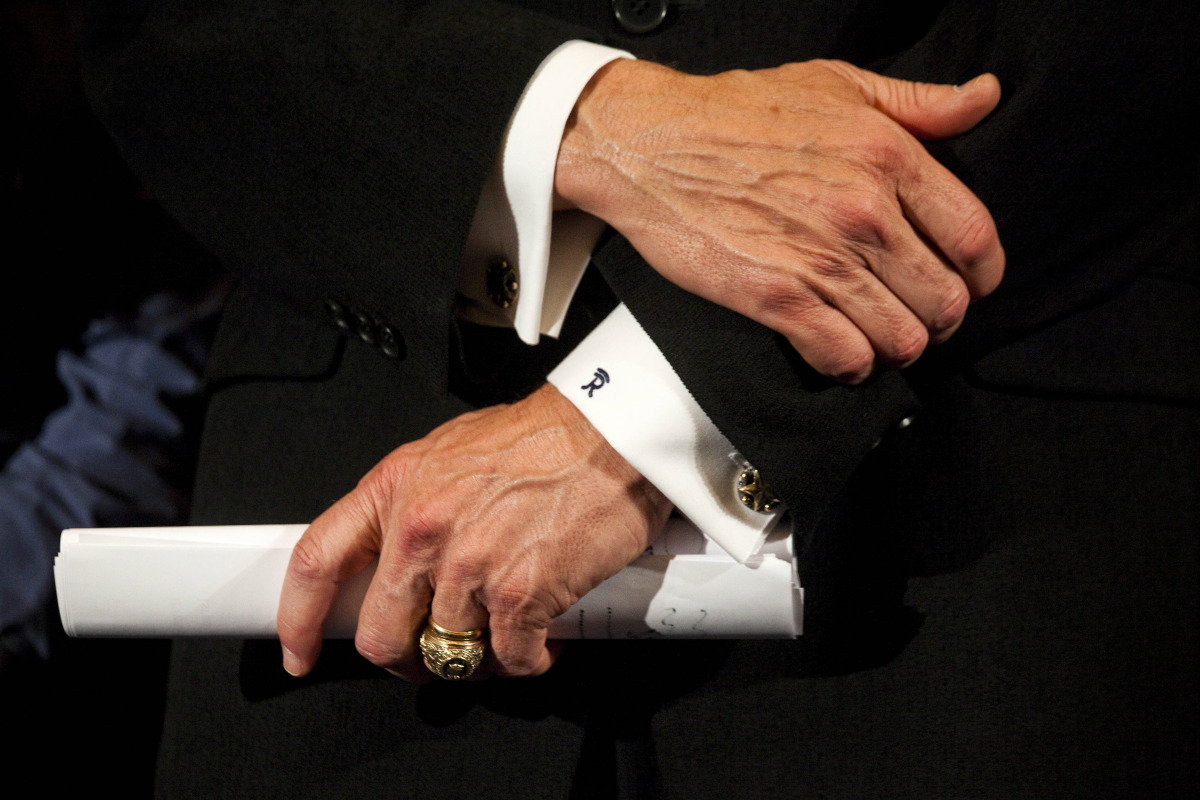 Perry shows off his Aggie ring, his wedding ring, his personal monogram and his favorite cuff links.