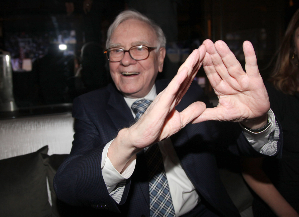 The Oracle of Omaha flashes the diamond sign at the re-opening of Jay-Z's New York City club 40/40.