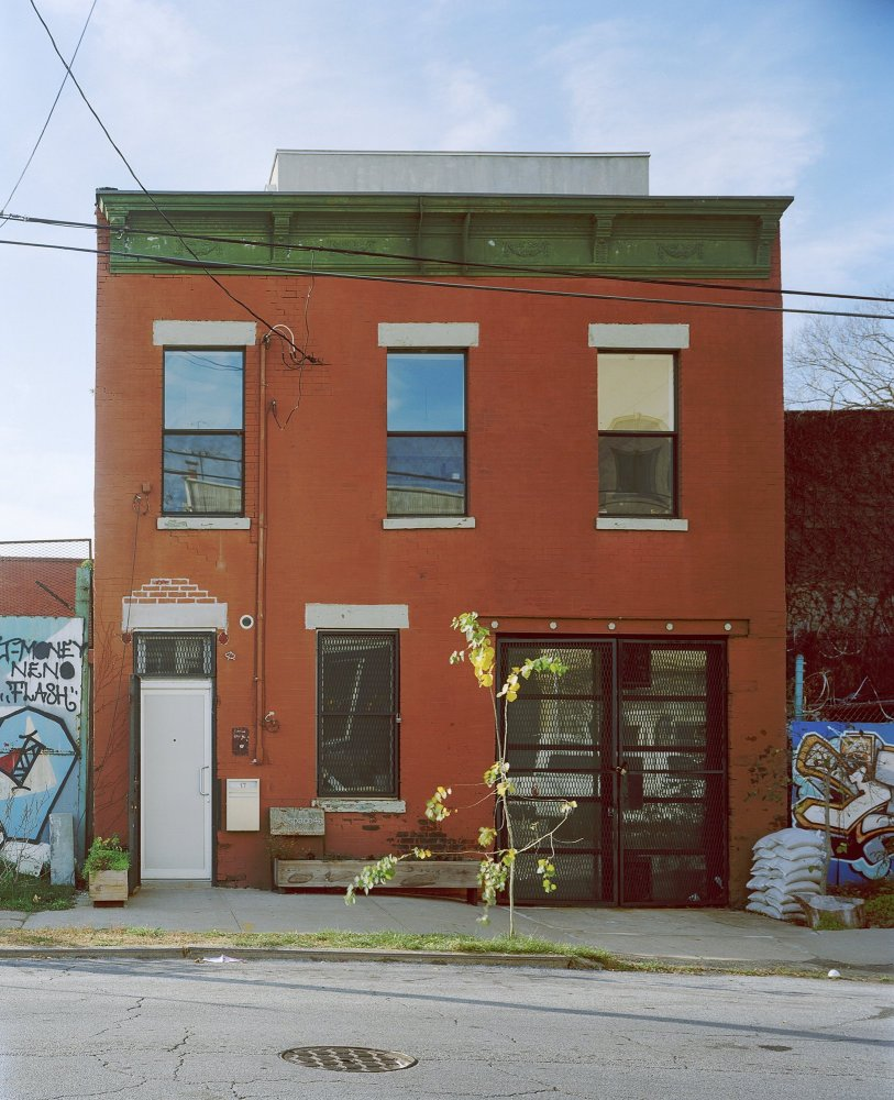 Surrounded by the graffiti and barbed  wire of the neighborhood, Thomas's carriage house is a diamond in the rough.