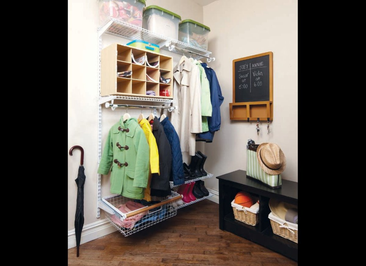 There's no need to leave damp coats and muddy footprints around the house. Create a mudroom with a shoe rack, coat rack and a