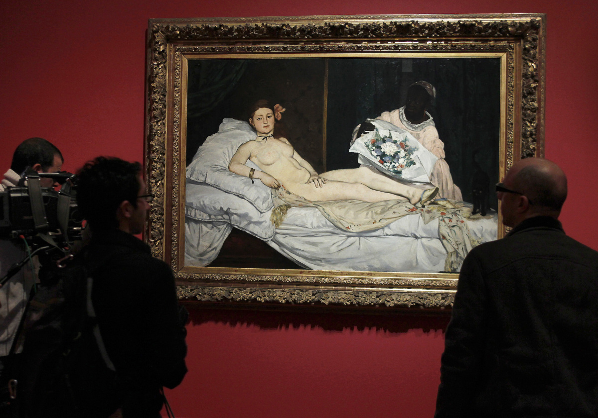"People look at the painting ""Olympia"" made on 1868 by French impressionist artist Edouard Manet during the press visit of the"