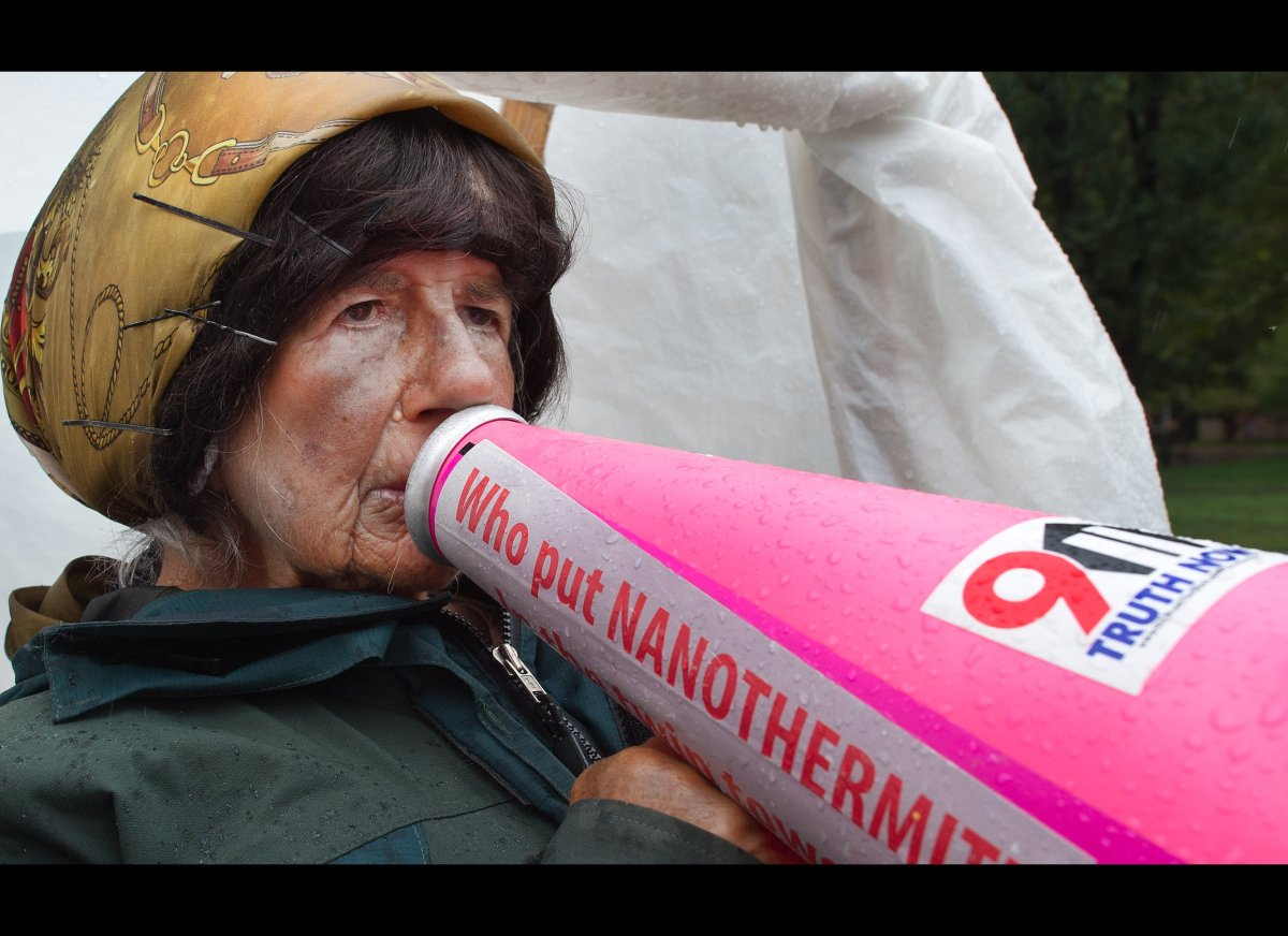 Concepcion Picciotto, who is better know as Connie the President's neighbor, yells into a megaphone as she protests from her