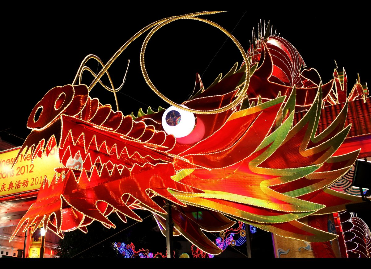 A large illuminated dragon is seen in Chinatown on January 22, 2011 in Singapore. Thousands of people converged on Chinatown