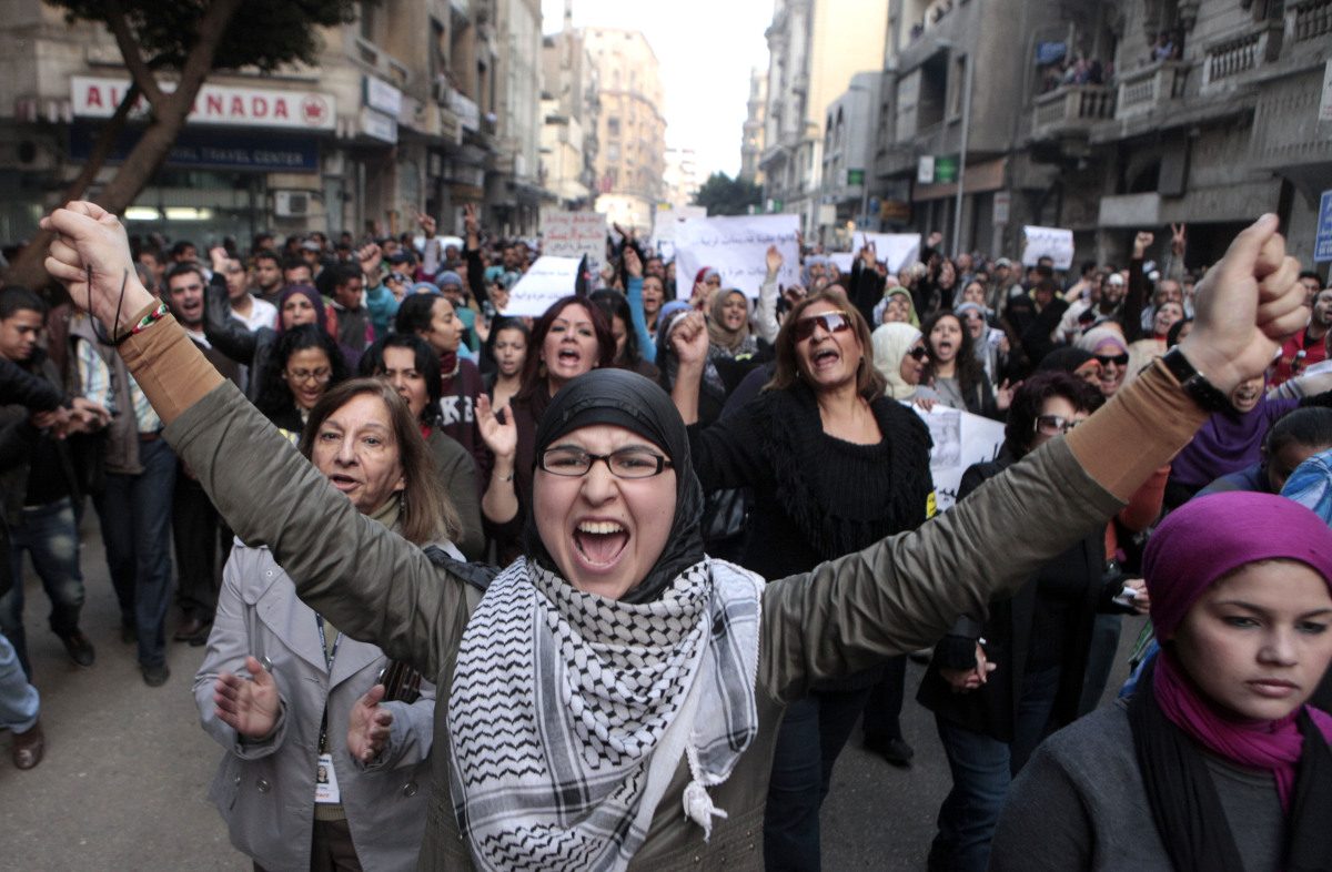 Hundreds of Egyptian women march at Cairo streets during a protest as they angered by the recent violence used against them i