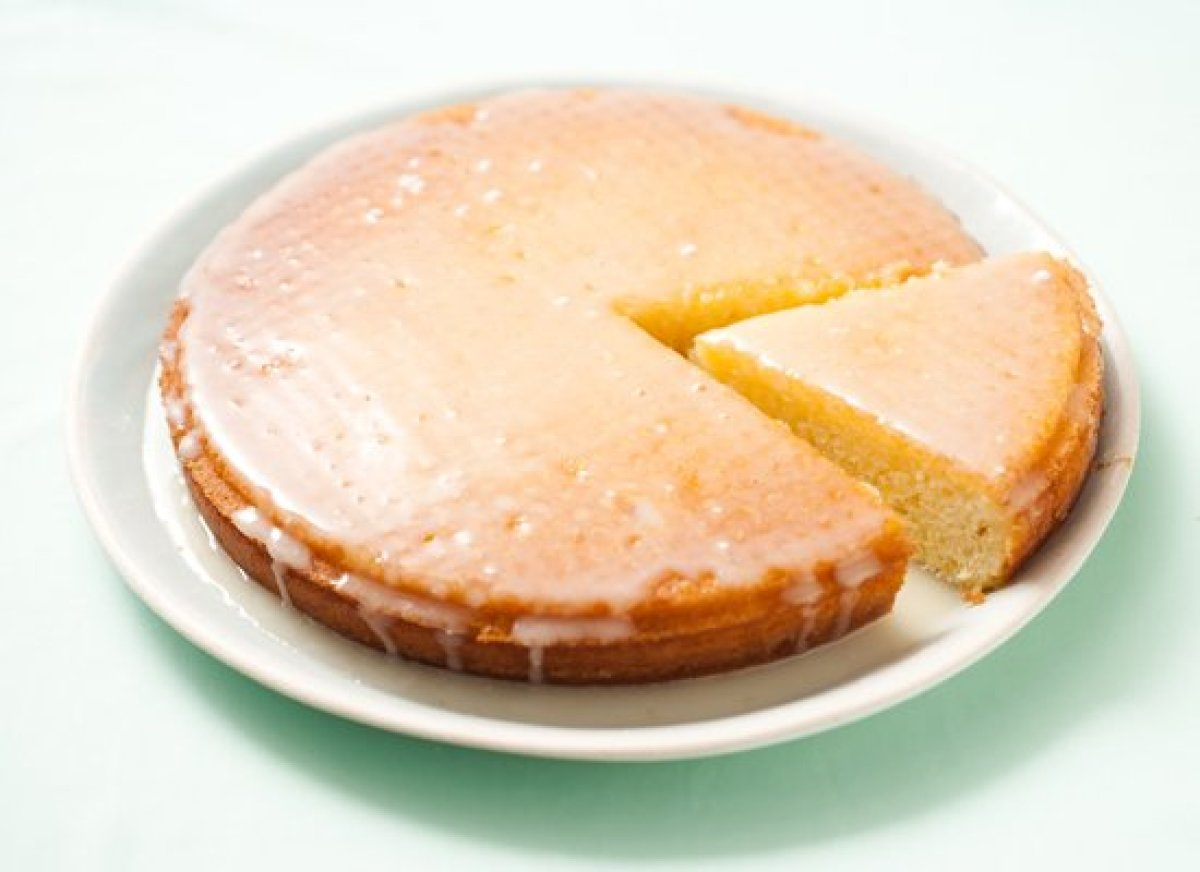 This simple cake uses both the juice and the zest of an orange and a lemon -- the zest goes in the cake batter and the juice