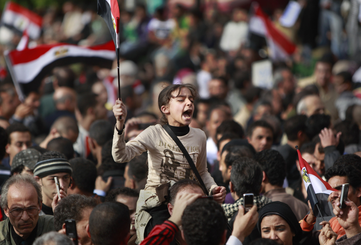 "Thousands gather in Cairo's Tahrir Square to press for an end to Mubarak's rule in a ""Day of Departure."""