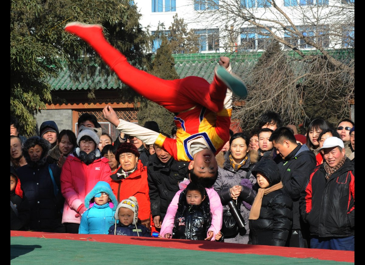 In a picture taken on January 23, 2012, a child performs at a temple fair on the first day of the Lunar New Year in Beijing.