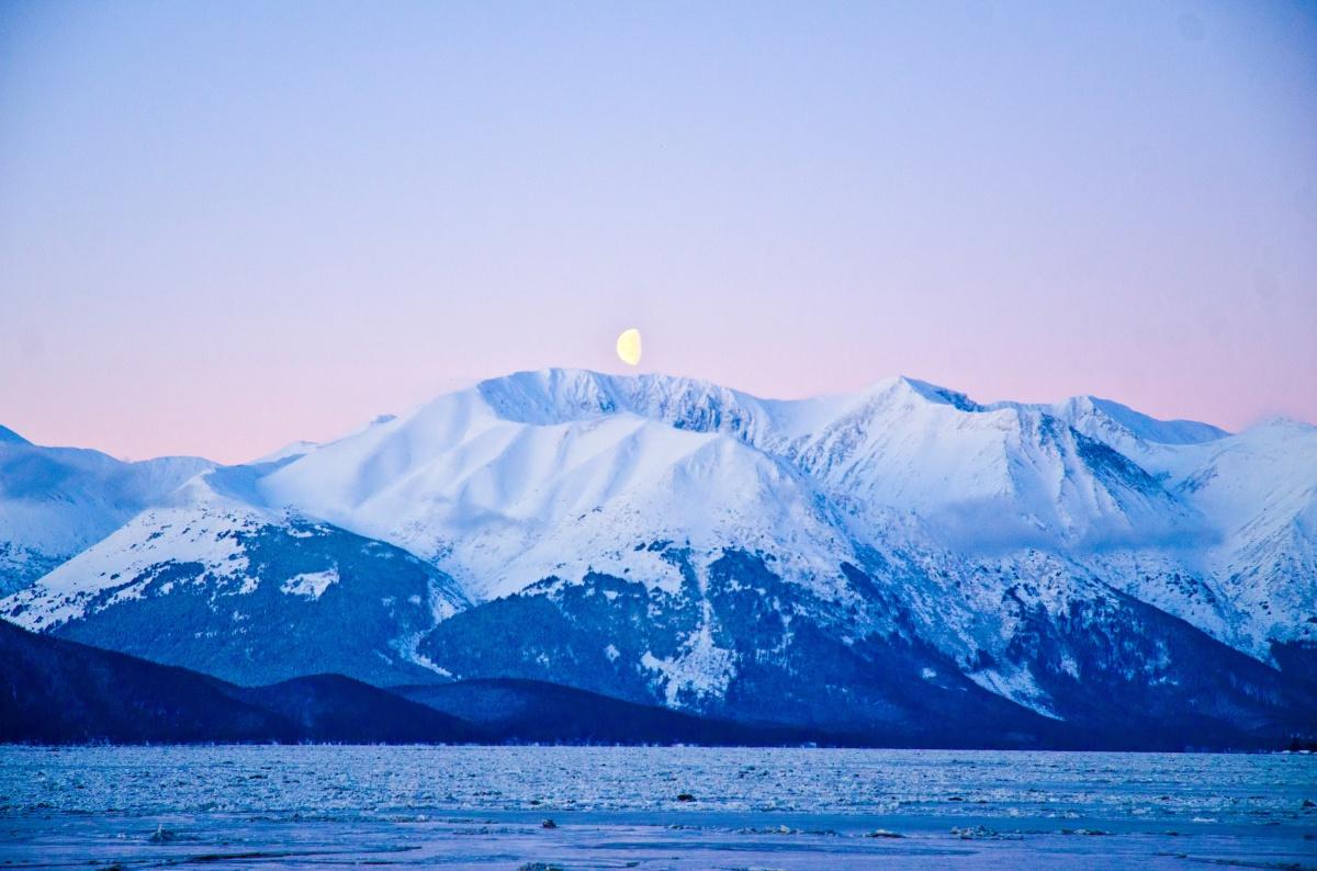 Early morning moonset over Turnagain Arm, Alaska.  <em>Photo: Chris Owens</em>