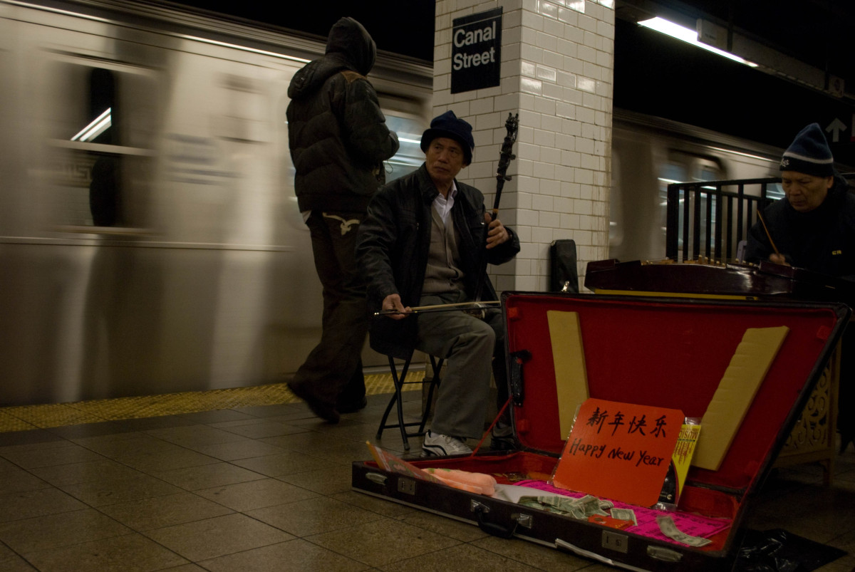 The day's journey began at the Canal Street stop off the Q train. Underground, a musical duo plays Chinese classical music: t