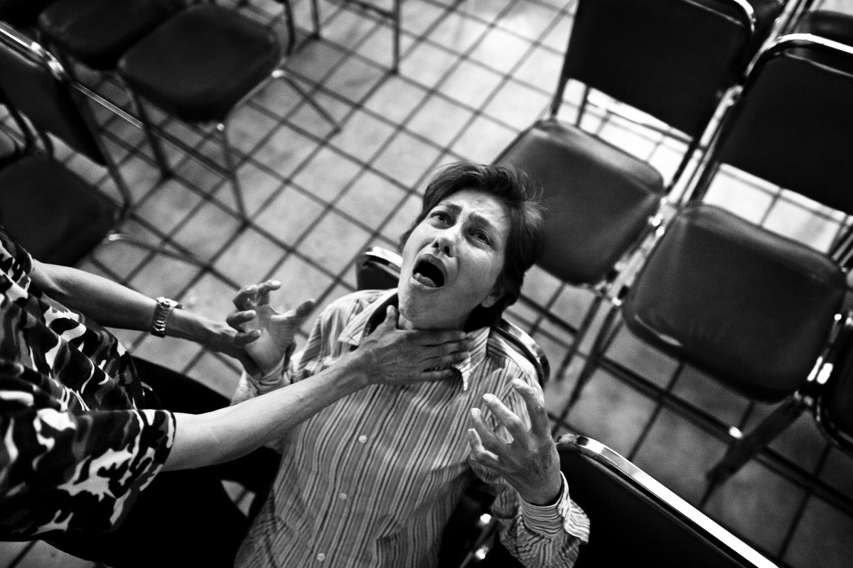 A Mexican woman screams intensively during the exorcism rite practiced at the Church of the Divine Saviour in of Mexico City,
