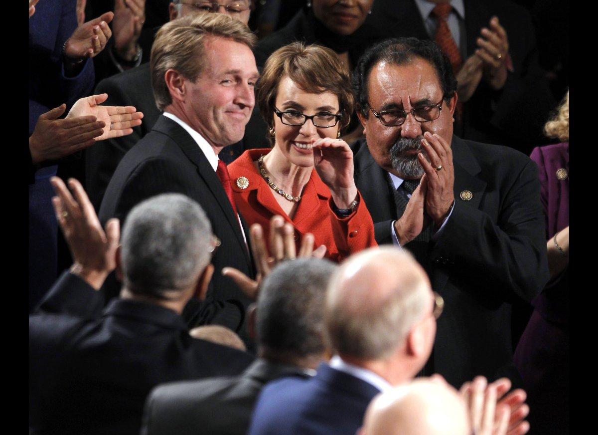 Retiring Rep. Gabrielle Giffords, D-Ariz., flanked by Rep. Jeff Flake, R-Ariz., left, and Rep. Raul Grijalva, D-Ariz., on Cap