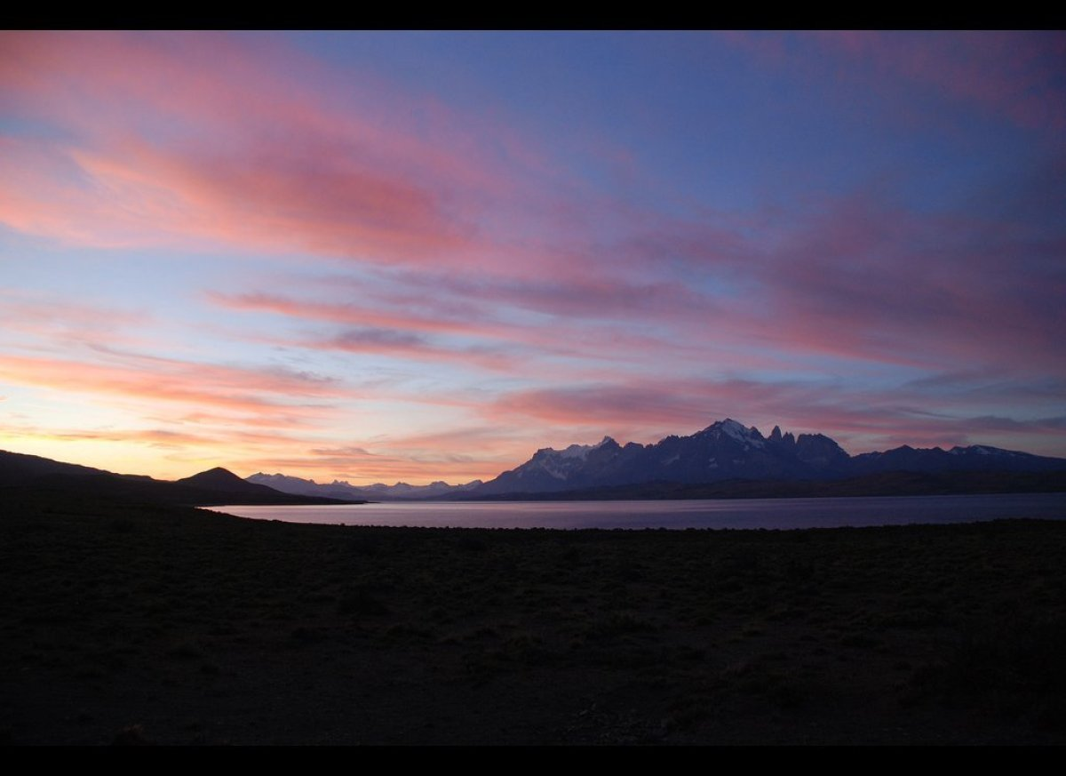A resplendent sunset across Lake Sarmiento to the Monte Almirante Nieto and the Torres seen from the Tierra Patagonia Hotel.