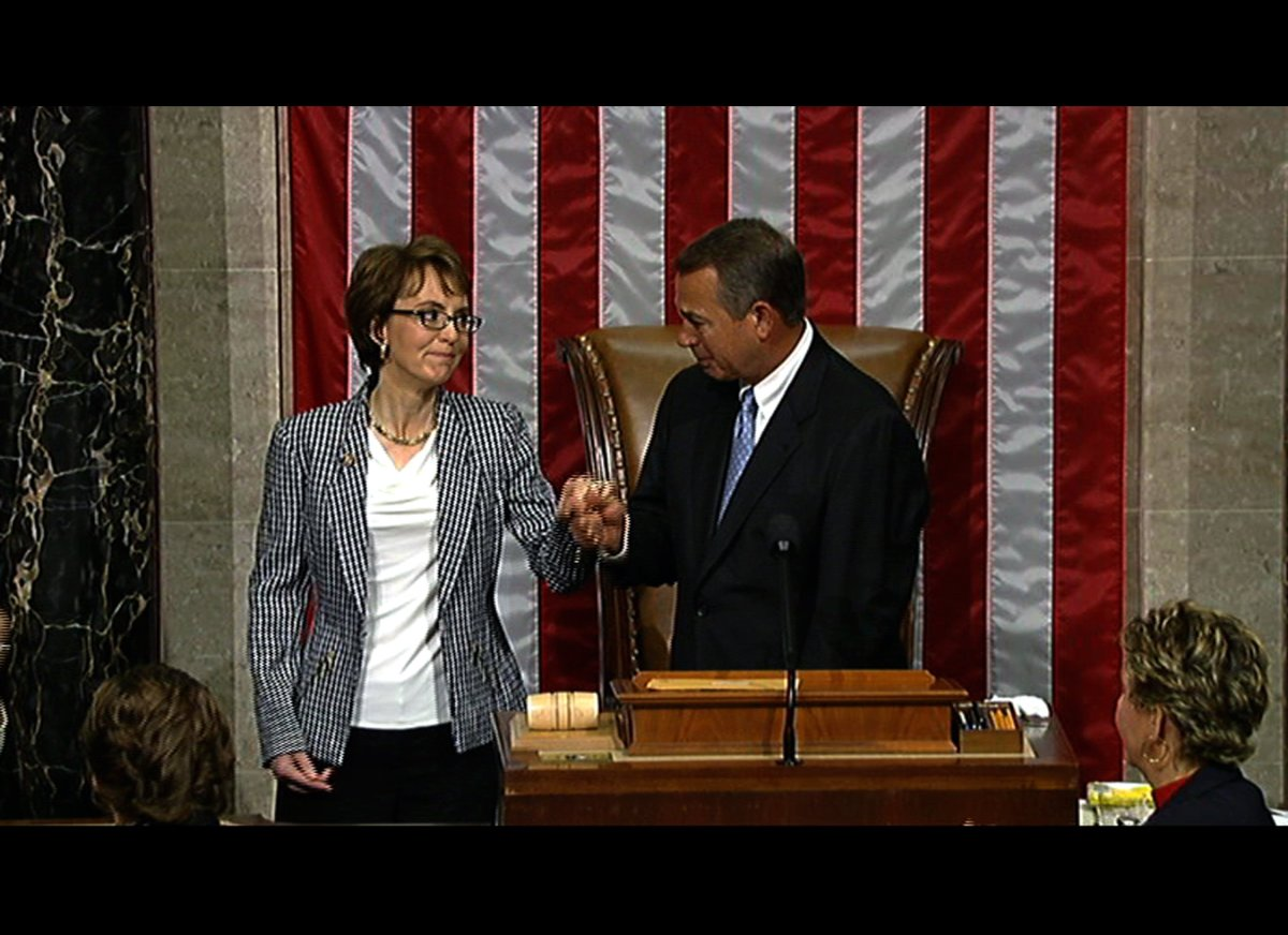 This video image provided by House Television shows Rep. Gabrielle Giffords, D-Ariz. and House Speaker John Boehner of Ohio,