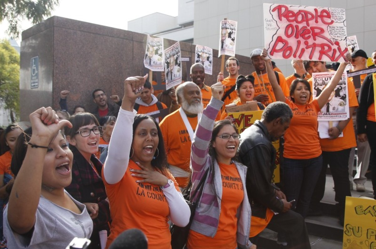 Los Angeles residents with the Californians United for Responsible Budget, CURB, alliance protest Sheriff Lee Baca's proposal