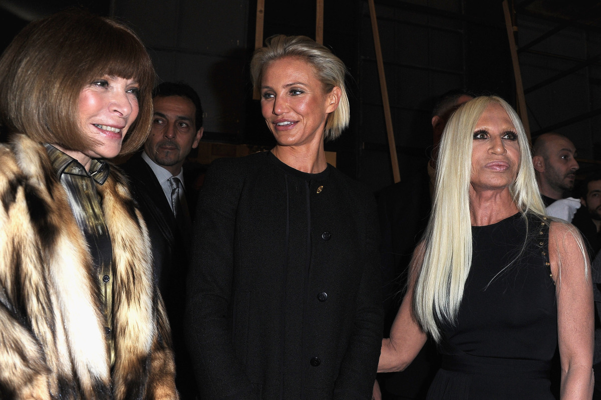 With Anna Wintour & Donatella Versace. (Getty photo)