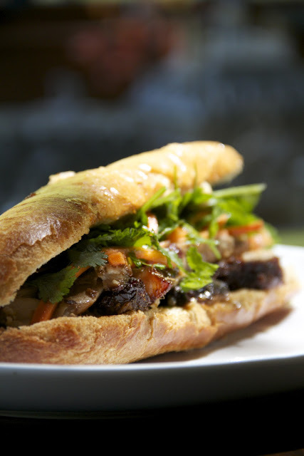 """<strong>Get the <a href=""""http://www.mongastronomy.com/2012/05/sandwich-day-pork-belly-banh-mi.html"""">Pork Belly Banh Mi recipe"""